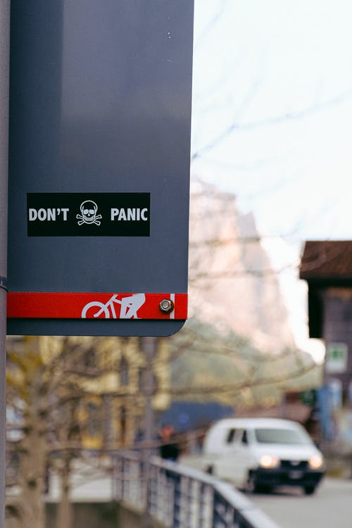 Don't Panic Sticker on Sign