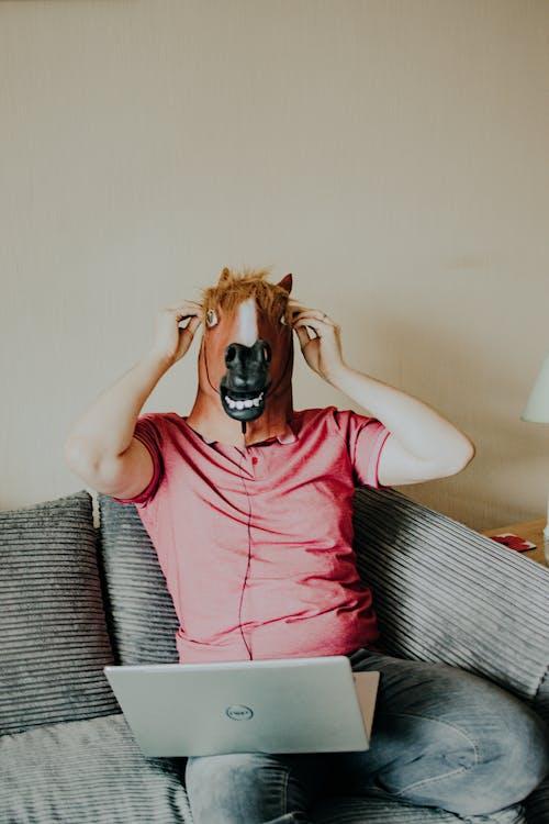 Man Wearing A Horse Mask