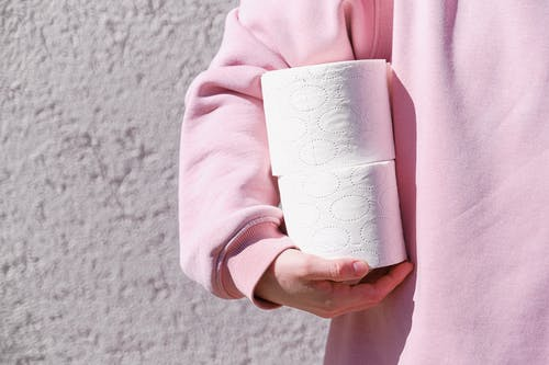 Person In Pink Sweater Holding White Tissue Paper