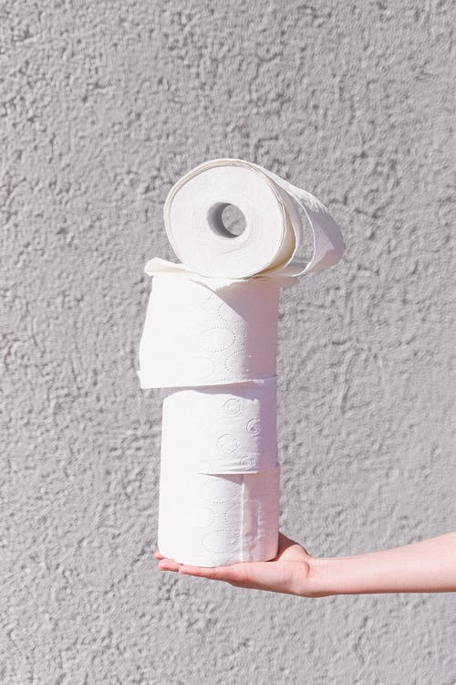White Toilet Paper Rolls On White Wall