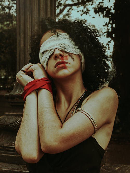 Woman In Black Tank Top Blindfolded