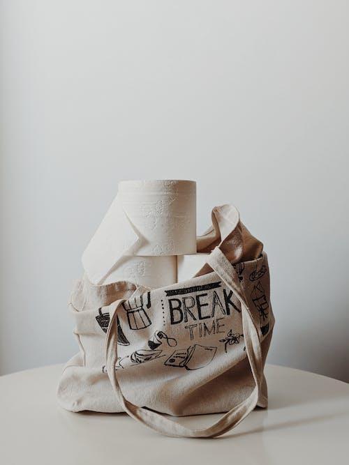 Toilet Paper Rolls inside Tote Bag