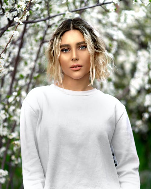Woman In White Sweater Standing Near A Tree