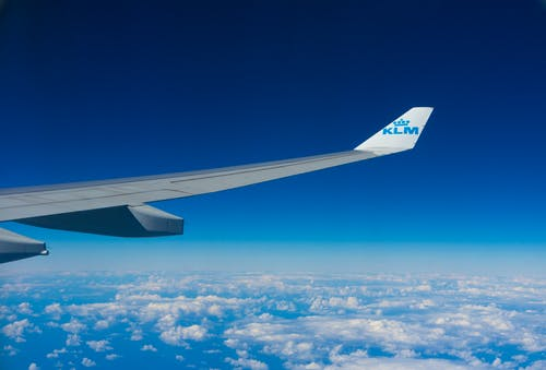 Photo of White and Blue Klm Plane