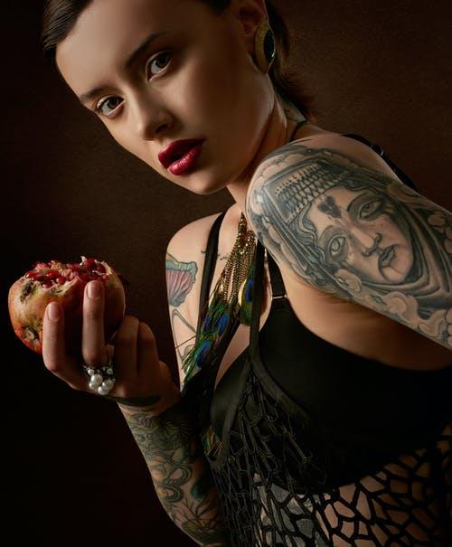 Woman Holding Pomegranate Fruit