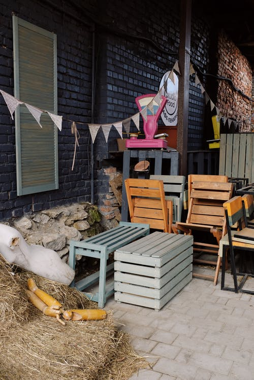 Yard of creative cafe with chairs and wooden boxes