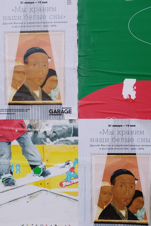 Set of various colorful banners placed on wall on street