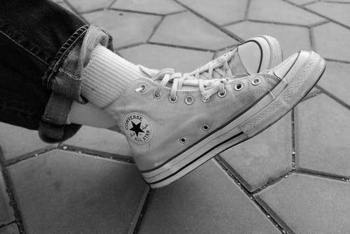Grayscale Photo of Converse All Star High Top Sneakers