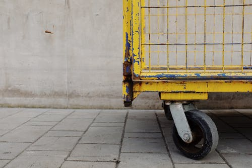 Yellow and Black Metal Cart on Gray Concrete Floor
