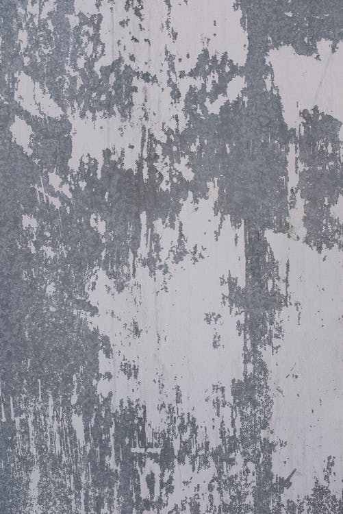 Shabby concrete wall fragment texture with scratches and cracks