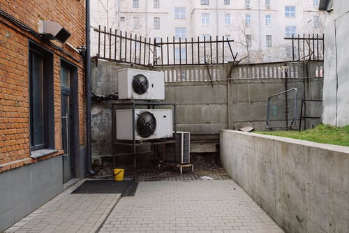 Air conditioning in yard of building