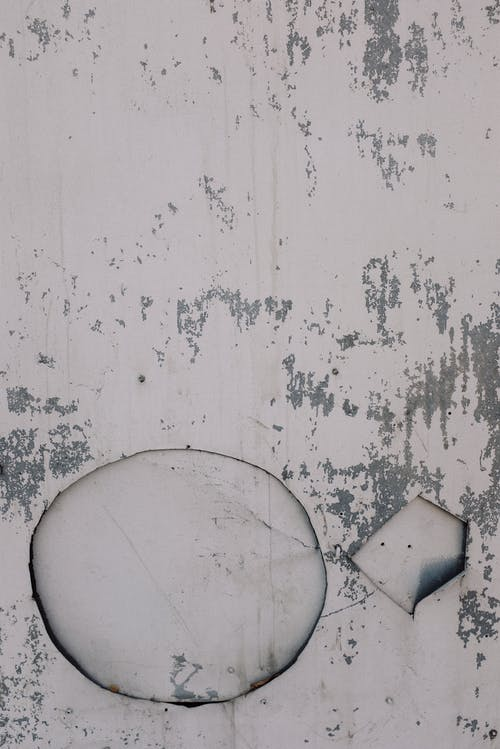 Shabby stucco surface with stains
