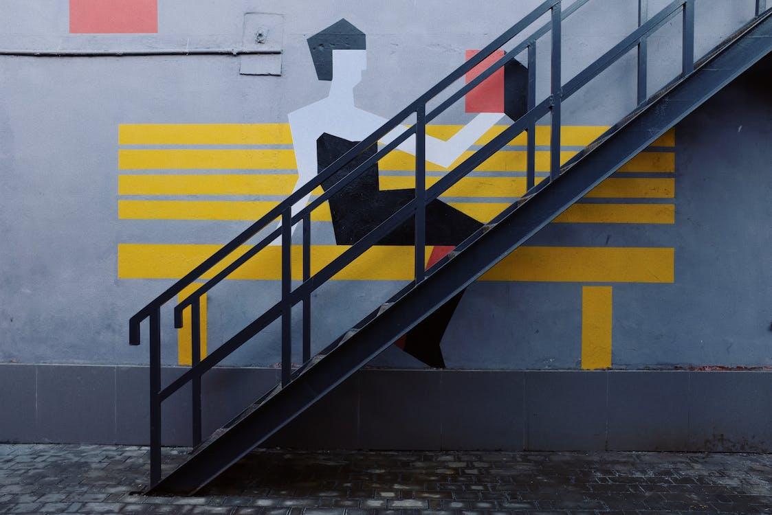 Black Metal Staircase Next to a Drawn Gray Concrete Floor