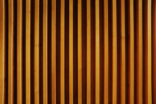 Striped wall constructing from wooden planks