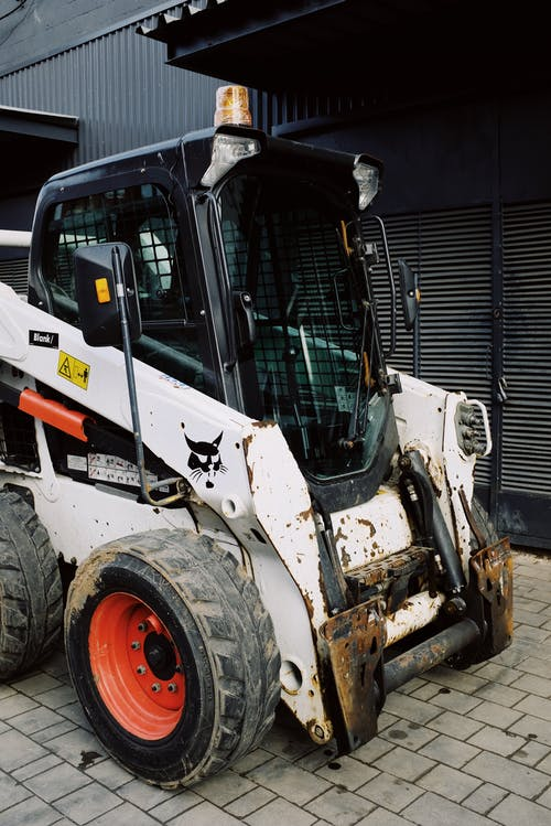 Mini loader preparing for service and repairing