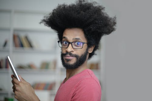 Man in Black Framed Eyeglasses and Pink Crew Neck Shirt