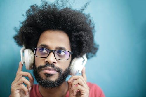 Man in Black Framed Eyeglasses Wearing Headphones