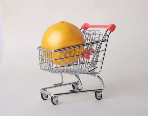 Yellow Round Fruit on Stainless Steel Shopping Cart