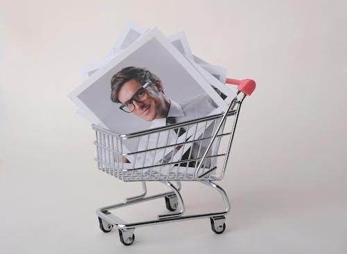 Photo of Man in Black Framed Eyeglasses in Shopping Cart