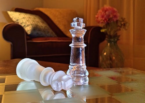 White King Chess Piece on Chess Board