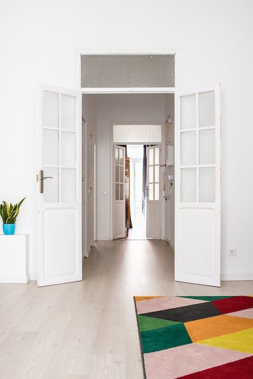 Wide Open White Wooden Door