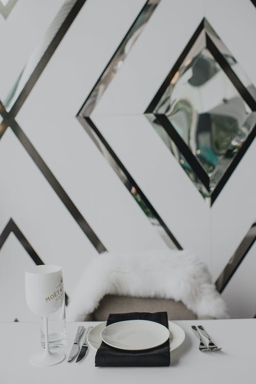Creative served table at white wall with geometric pattern and crystal elements