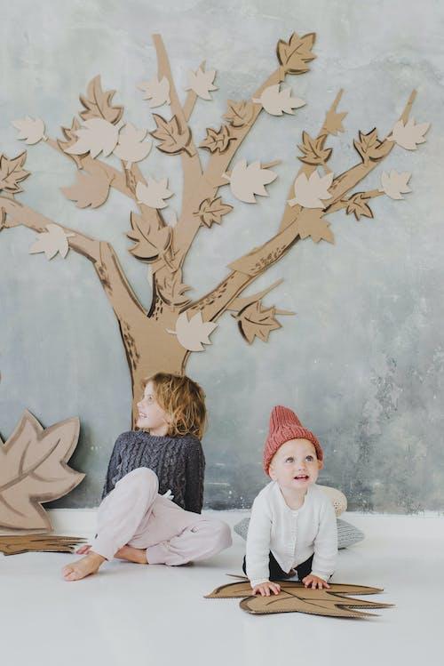 Kids Having Fun with Maple Tree Cardboard Cutouts