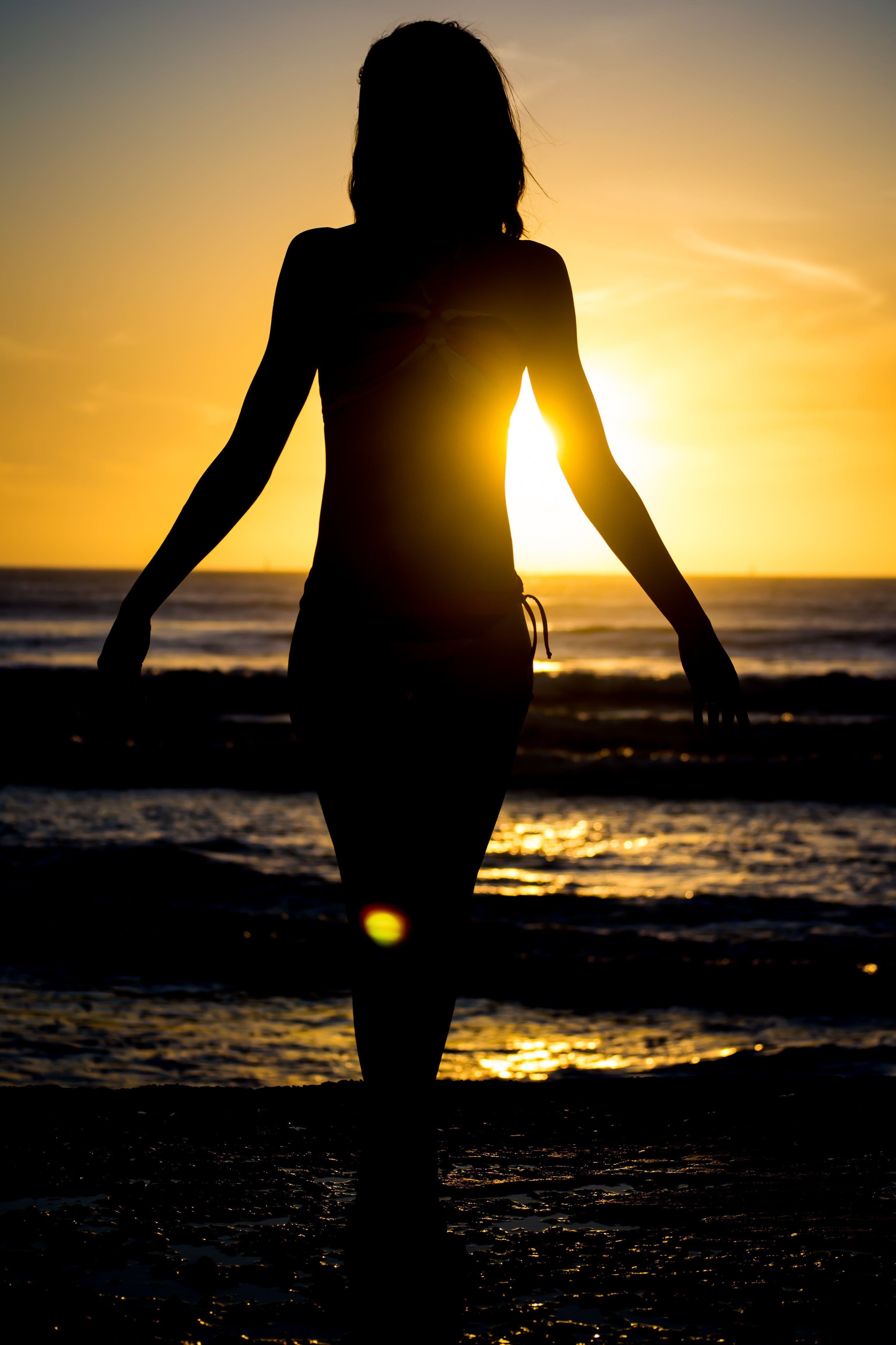 Woman Walking at the Beach during Sunset