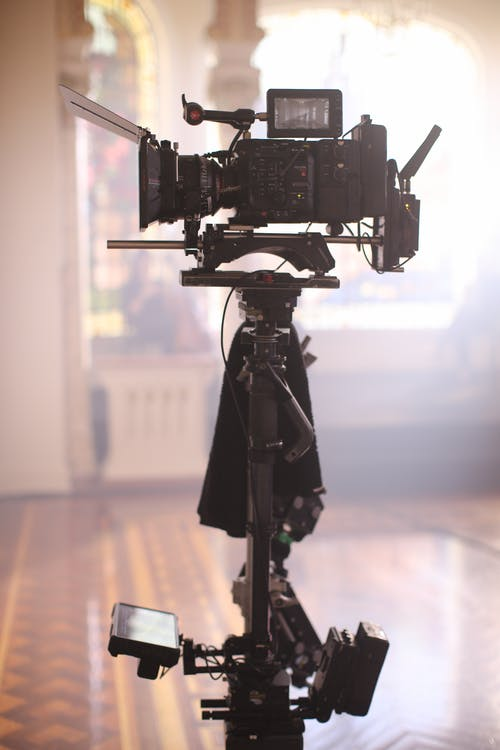 Black Video Camera On Tripod