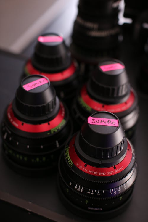 Camera Lenses On Black Surface