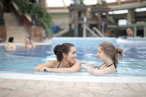 2 Women Chatting in Swimming Pool