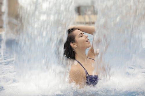 Woman in Blue Bikini Top in Water