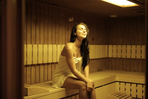 Beautiful Woman Sitting in Sauna