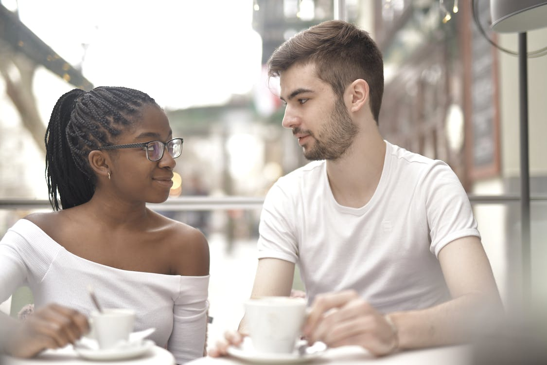 Couple Having Coffee Looking at Each Other