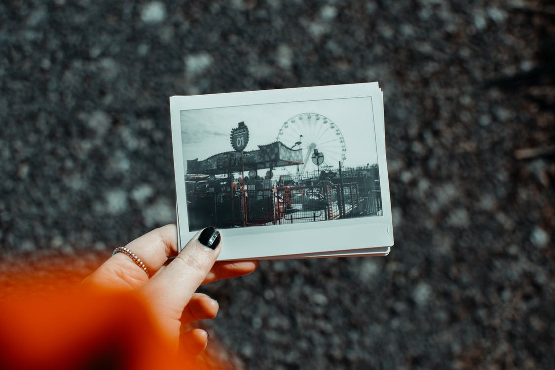 Woman Holding Polaroid Pictures