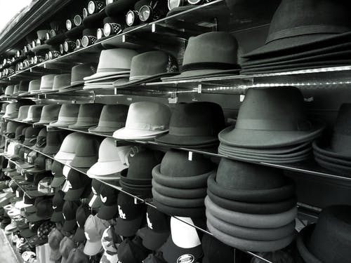 shelf full of hats