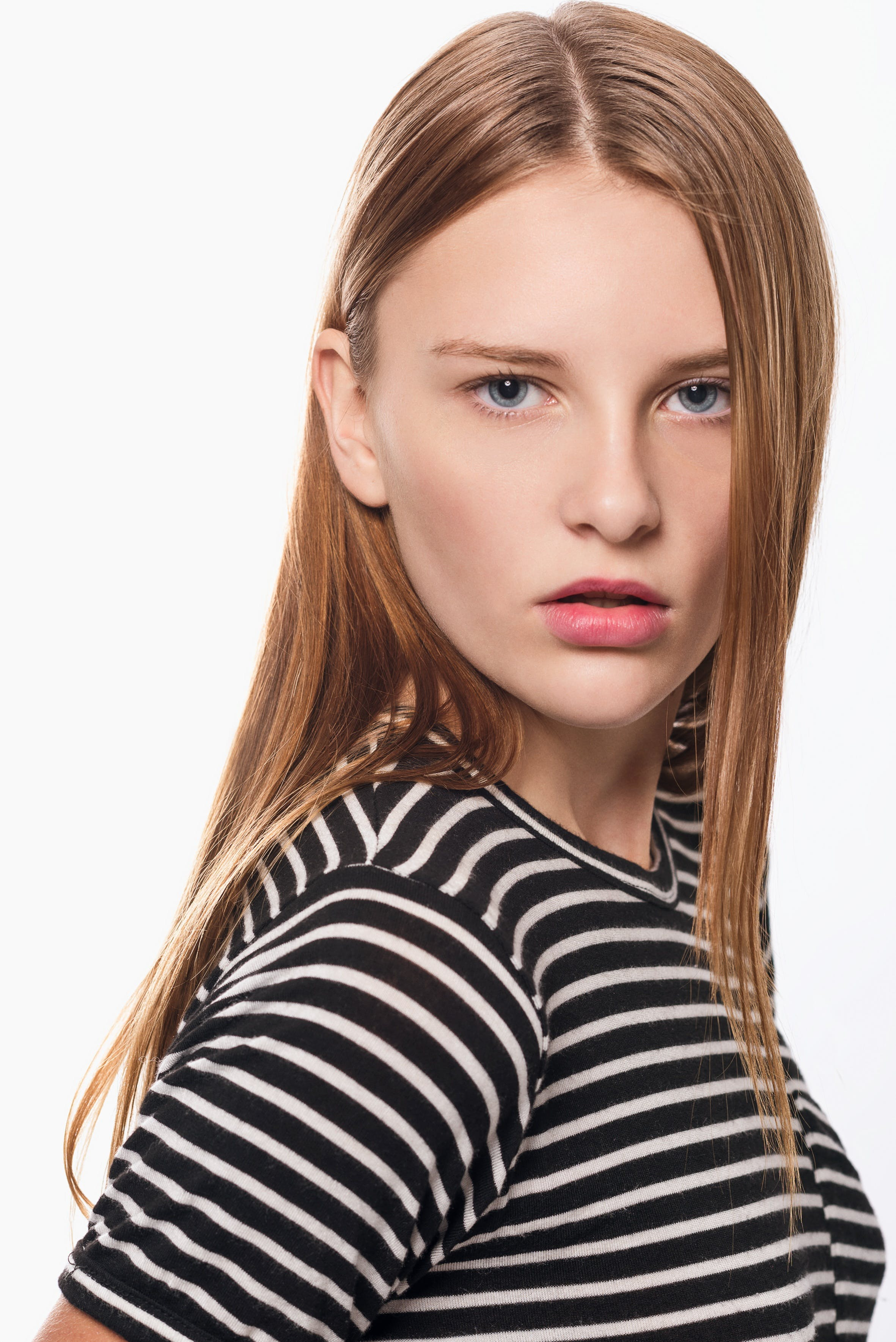 Woman in Black and White Striped Top