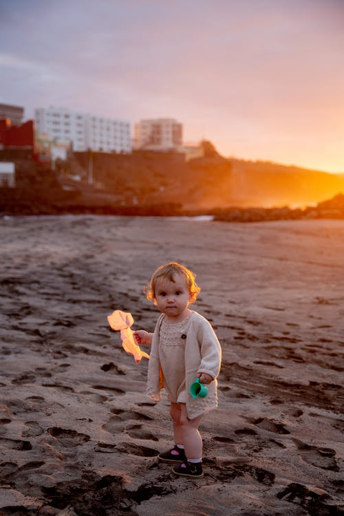 Little Girl Playing On the Sand