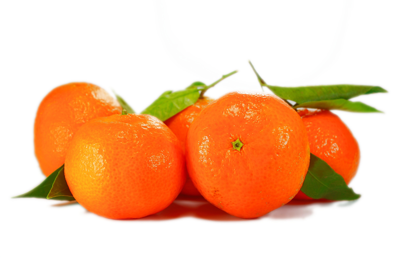 Five Orange Fruits on White Surface