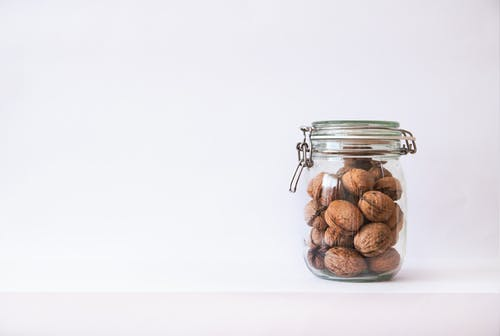 Clear Glass Jar With Walnuts