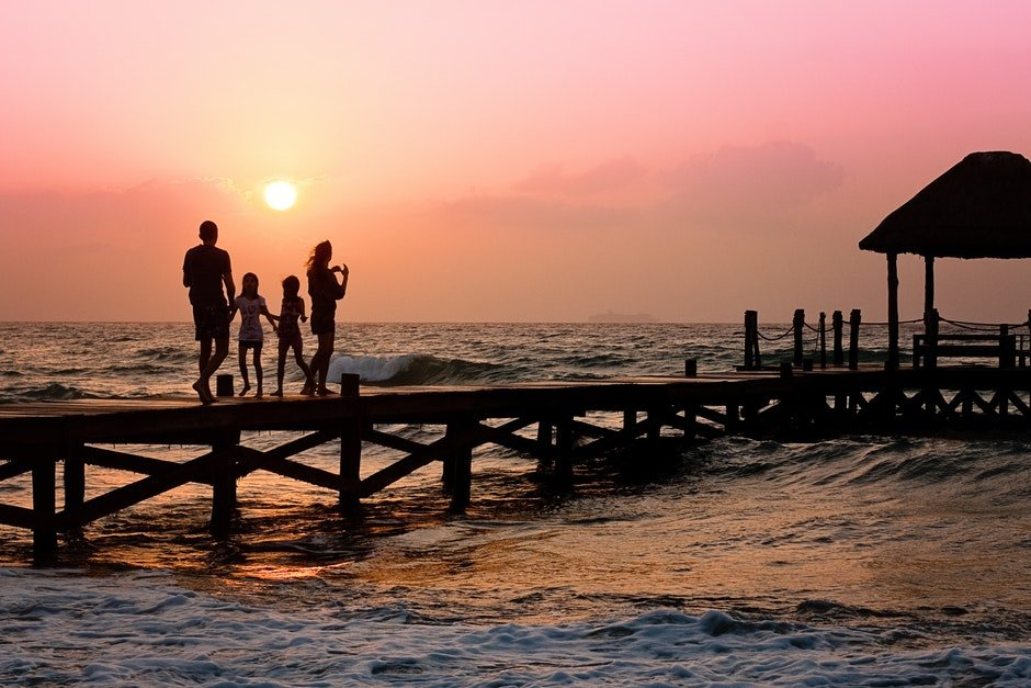 People Standing on Dock during Sunrise