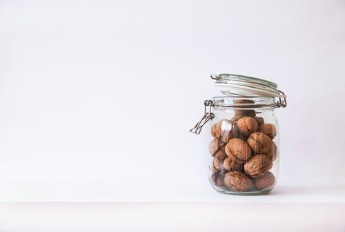 Free stock photo of background, chestnuts, glass, glass jar
