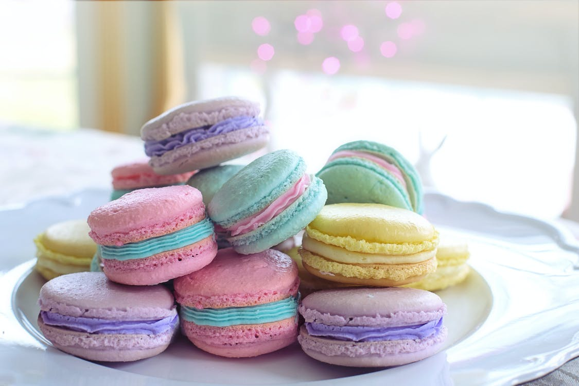 Colorful Macarons on White Ceramic Plate For Easter