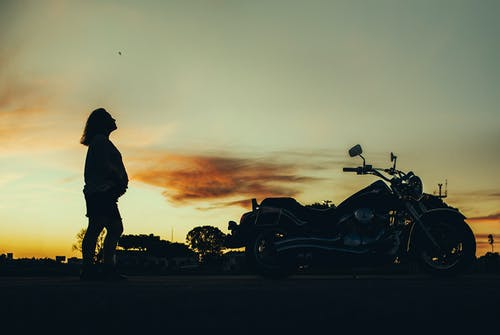 Silhouette of Pregnant Woman Near Motorcycle during Sunset