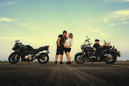 Couple Posing Near Motorcycles