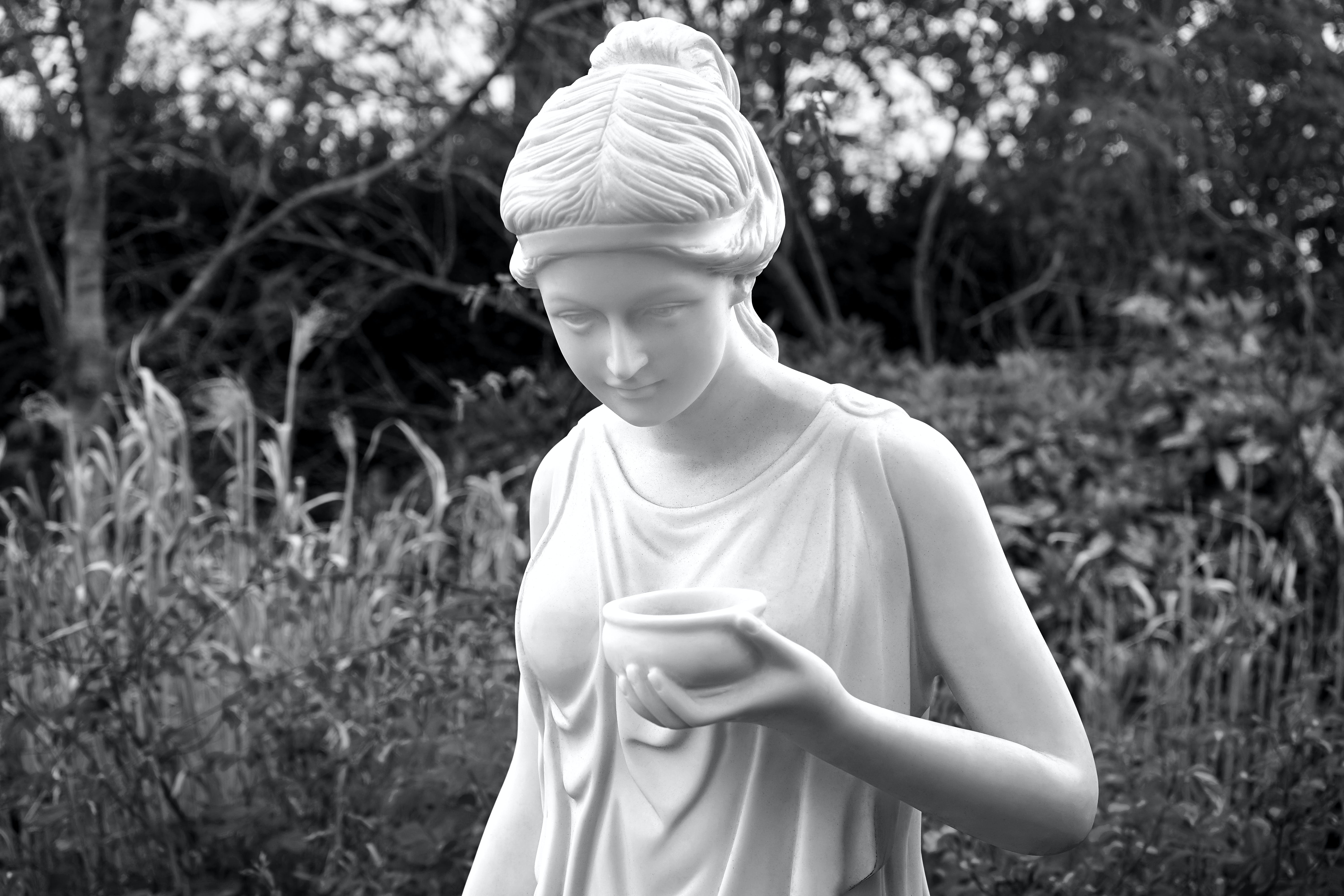 Woman Holding Bowl Statue