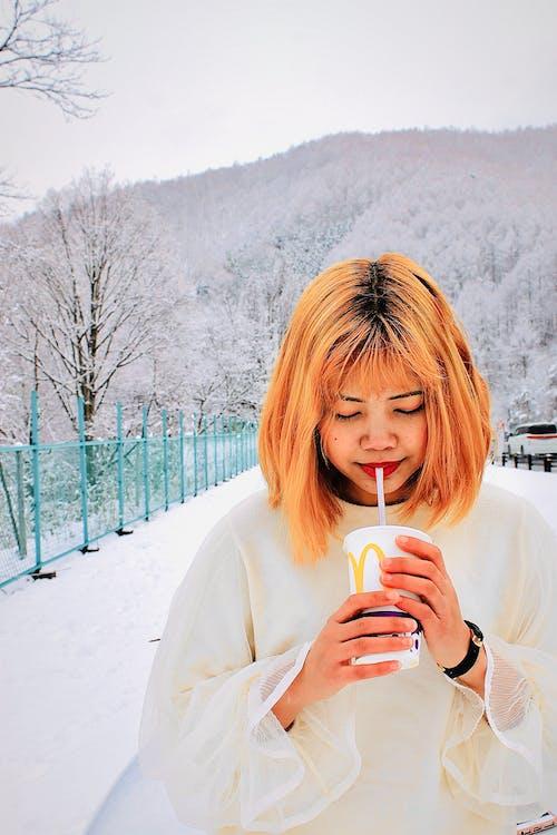 Free stock photo of beautiful girl, drinking straw, orange hair