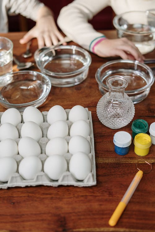Colorful Paints, White Eggs and Clear Glass Bowl For Making Easter Eggs