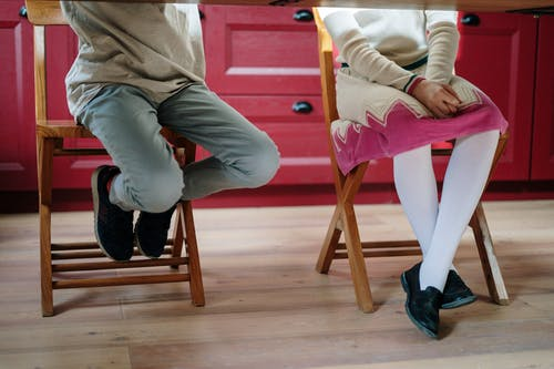 Kids Sitting on Wooden Chairs