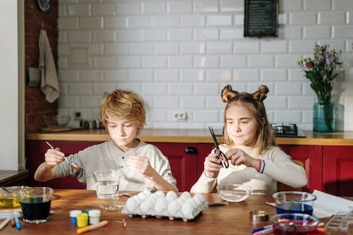 Siblings Doing DIY Easter Eggs